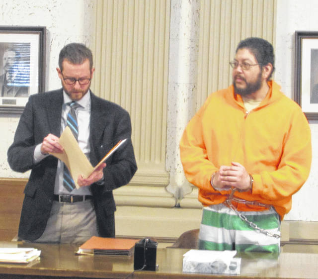 Alex Treece, attorney, left, and his client Joseph Garcia appeared in Putnam County Common Pleas Court Thursday where Garcia plead guilty on a charge of rape.