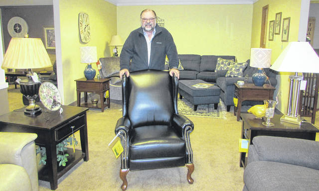 Jim Heringhaus, owner of Heringhaus Furniture, poses in the furniture showroom. The family-owned business now has members of a fourth generation involved in bringing style to homes in the region.