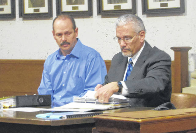 Michael Huizenga, left, appeared in Putnam County court Monday on rape allegations, represented by his attorney, E. Charles Bates.