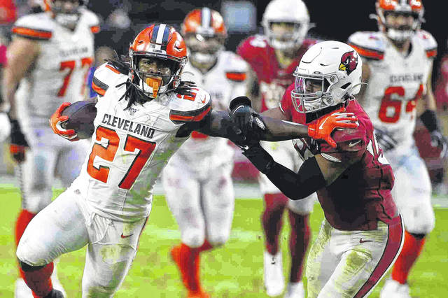Cleveland Browns running back Kareem Hunt (27) carries the ball during a game against the Arizona Cardinals on Dec. 15. Browns owner Jimmy Haslam and coach Kevin Stefanski have spoken to Hunt and Odell Beckham Jr. about off the field issues.
