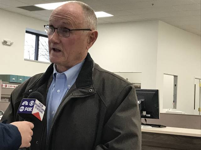 Former Allen County Sheriff Dan Beck talks to the media after declaring his independent candidacy for Allen County commissioner.