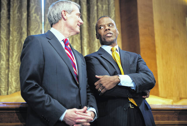 Sen. Rob Portman, R-Ohio, left, talks with former Rep. J.C. Watts, R-Okla., during a forum with Insight America. Tribune Media Photo
