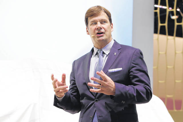 Jim Farley, Jr. executive vice president and president of Global Markets of the Ford Motor Company, is shown in this photo during New York International Auto Show, at the Javits Convention Center, Wednesday, March 28, 2018. (AP Photo/Richard Drew)