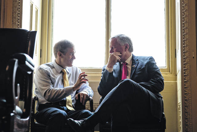 Representatives Jim Jordan, left, will be the top Republican on the Judiciary Committee, and Rep. Mark Meadows of North Carolina, right, will serve as ranking member of the Oversight and Reform Committee. Tribune News Service Photo
