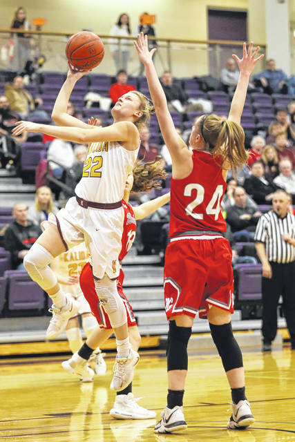 Kalida's Brenna Smith puts up a shot against Pandora-Gilboa's Lacie Fenstermaker (24) during a Thursday night Division IV girls sectional semifinal at Bluffton University.