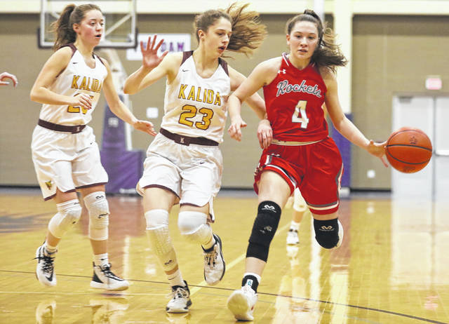 Pandora Gilboa's Alexis Augsburger keeps the ball away from Kalida's Brooke Erhart (23) during a Thursday night Division IV girls sectional semifinal at Bluffton University.