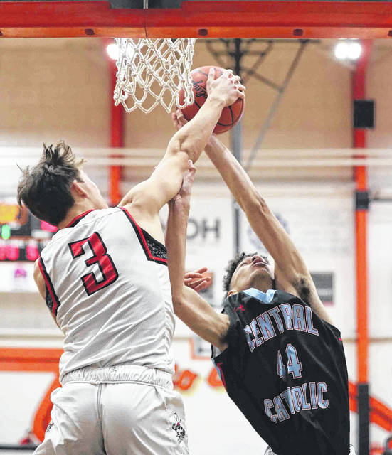 Bluffton's Jonathan Schriner (3) and Lima Central Catholic's Rodney Bennett battle for a rebound during a Friday night Division III sectional final at Elida.