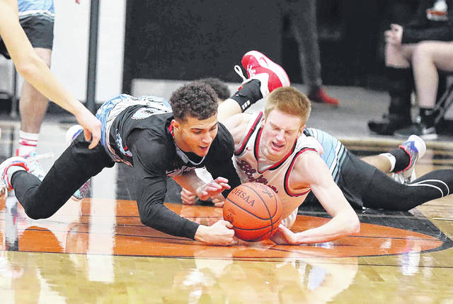 Lima Central Catholic's Rossy Moore, left, and Bluffton's Mason Soper try to retrieve a loose ball during a Friday night Division III sectional final at Elida.