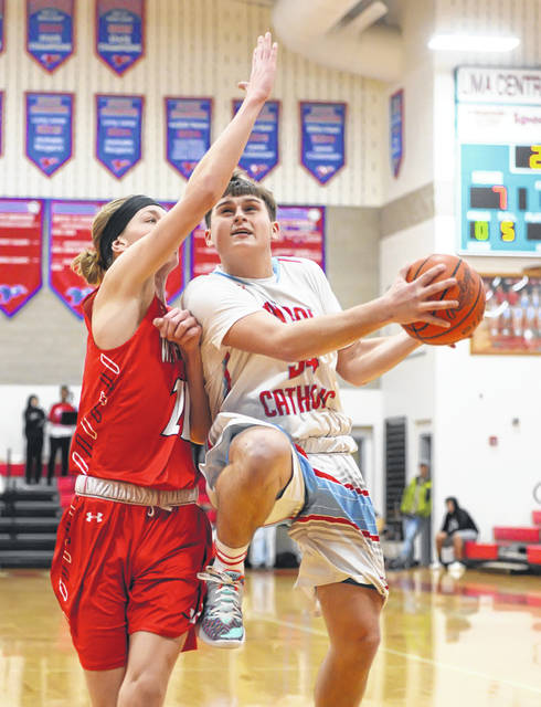 Lima Central Catholic's Michael Jay Riepenhoff goes up for a shot against Wapakoneta's Trey Ware during Tuesday night's game at Msgr. Edward C. Herr Gymnasium.