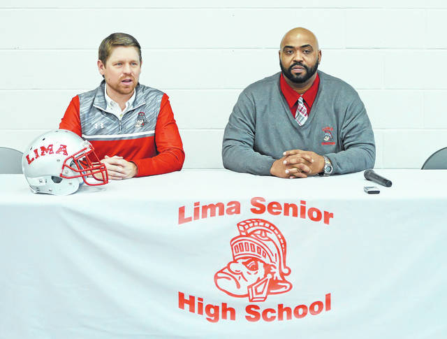"Lima Senior athletic director John Zell, left, introduces Alphonso ""Biggie"" Townsend as the school's new head football coach Thursday at Lima Senior High School."