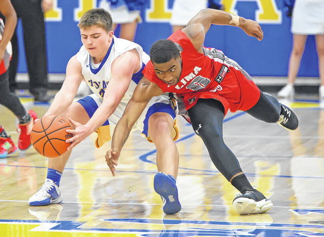 Lima Senior's Da'san Clair, right, and Findlay's Sam Weihrauch compete for a loose ball during Friday night's game at Findlay.