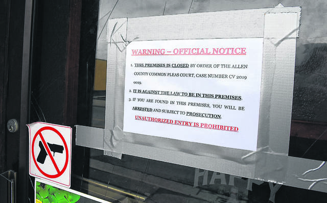 This file photo shows a sign on the door of the bar.