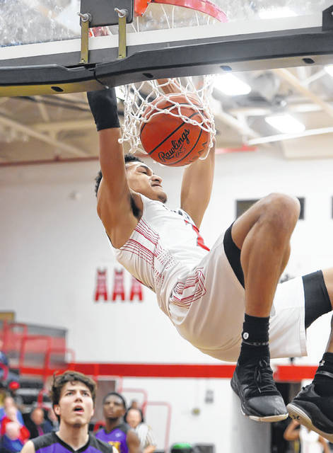 Lima Senior's Josiah Fulcher scores on a dunk during a Saturday Division I sectional final game against Toledo Waite at Fostoria High School.