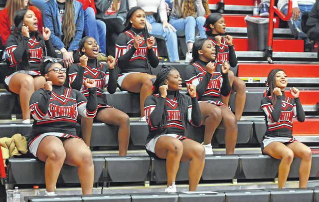 Lima Senior cheerleaders root for Spartans during a Saturday Division I sectional final game against Toledo Waite at Fostoria High School.