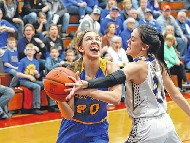 Hannah Will of Delphos St. John's drives to the basket against Miller City's Abi Teders during a Tuesday night Division IV sectional semifinal at Patrick Henry.