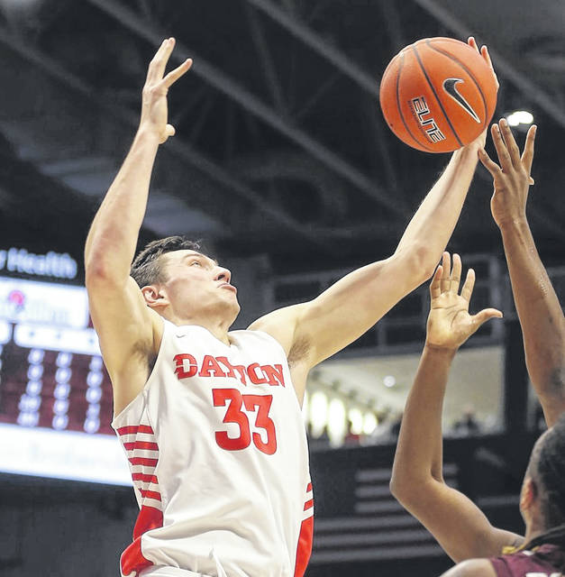 Dayton's Ryan Mikesell (33), of St. Henry, battles for a rebound during the Flyers' win over Fordham last Saturday.