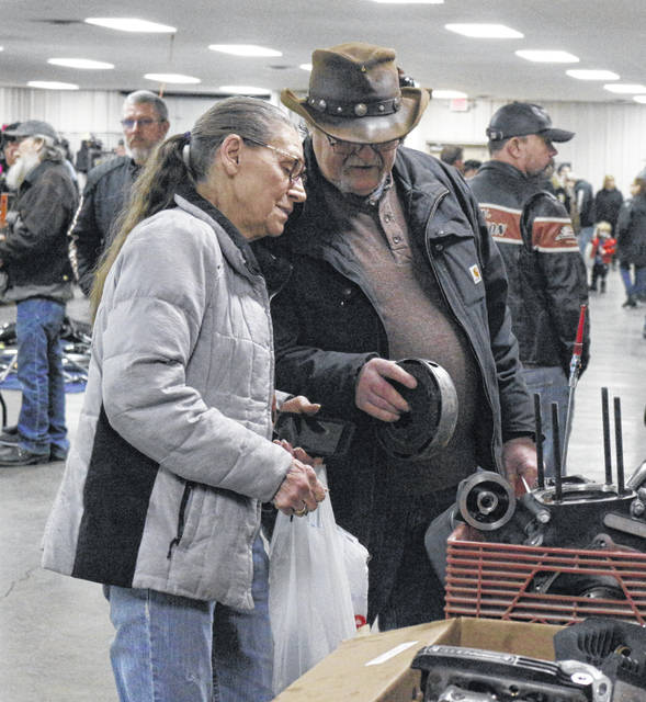 Cynthia and Carol Nash of Detroit look over motorcycle parts at the swap meet Sunday at the Allen County Fairgrounds.