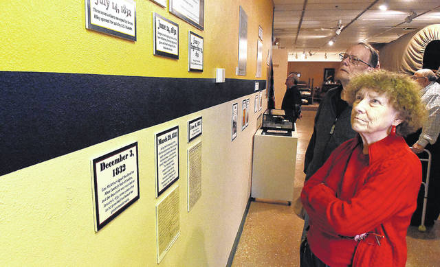 "Don and Jane Doty, of Lima, view the Allen County Museum and Historical Society exhibition ""Becoming Allen County"" on Wednesday afternoon. The museum staff welcomed Commissioner Greg Sneary, Mayor David Berger and the Allen County Historical Society board members to the reading of a proclamation commemorating the Bicentennial of Allen County's founding 200 years ago. The exhibit will be on display for the rest of the year."