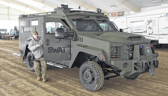 Allen County Sheriff's Office Sgt. Josh Bayer exits the new SWAT emergency rescue vehicle. The ERV is designed specifically to protect the occupants inside the vehicle.