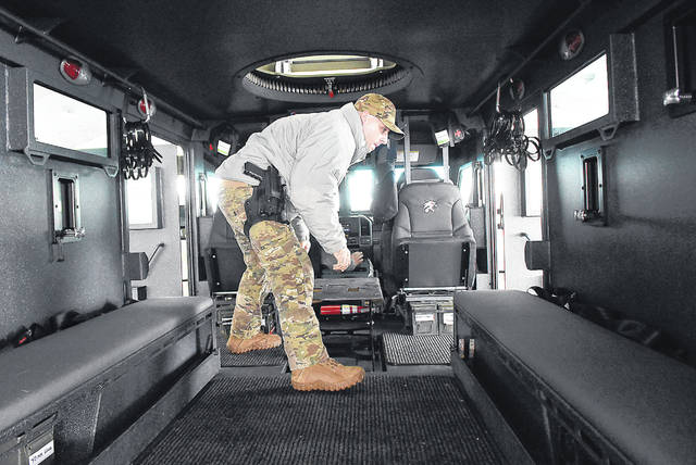 Sgt. Josh Bayer exits the side entrance of the new SWAT emergency rescue vehicle. No funds were needed from the sheriff's annual budget to make the $238,000 purchase. The armored vehicle was paid for with grants from the Department of Homeland Security and the state.