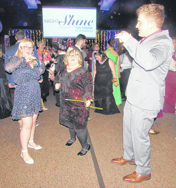 From left are Kaylin Mahoney, Ohio Northern University freshmen, Olivia Montgomery, of Findlay, and Josh Parker, ONU junior, dancing at Night To Shine at Lima First Church.