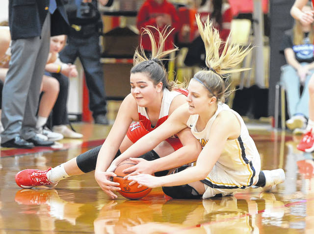 Ottawa-Glandorf's Peyton Warnecke, right, and Hicksville's Lindsay Bergman compete for a loose ball during a Saturday night Division III sectional final at Bluffton High School.