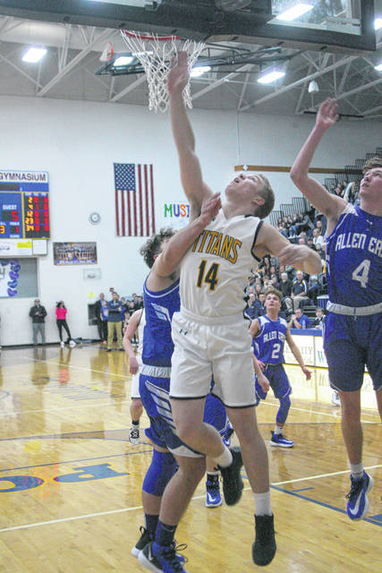 Ottawa-Glandorf's Will Kaufman puts up a shot during Friday night's Division III sectional final against Allen East at Miller City.
