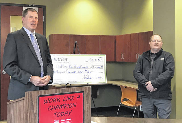 Joe Patton (left) accepts a $100,000 grant from Nutrien Lima general manager Todd Sutton (right) on Tuesday. Ohio Means Jobs - Allen County is getting ready to open its new workforce development conference center later this month.