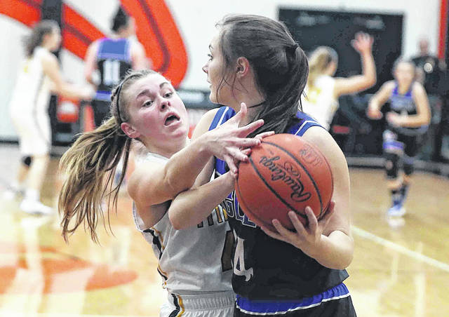 Ottawa-Glandorf's Kelsey Erford pressures Liberty-Benton's Sydney Elseser during a Thursday night Division III district semifinal at Elida.