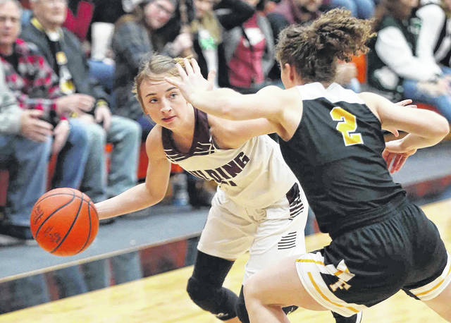 Paulding's Janae Pease looks to pass against Fairview's Carrie Zeedyk during a Thursday night Division III district semifinal at Elida.