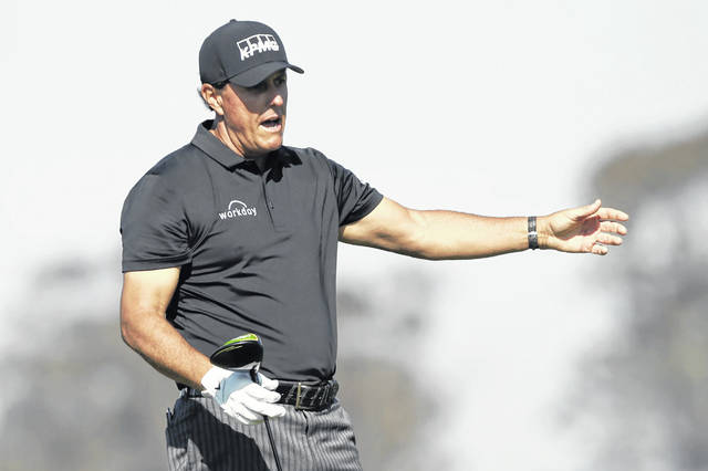 Phil Mickelson reacts to an errant tee shot during the Farmers Insurance golf tournament in San Diego earlier this year.