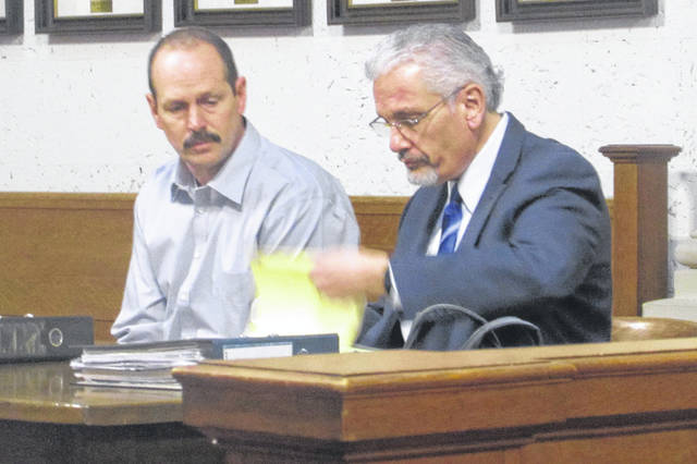 Michael Huizenga, left, appeared in Putnam County court Tuesday on rape allegations during the second day of the trial, represented by his attorney E. Charles Bates.