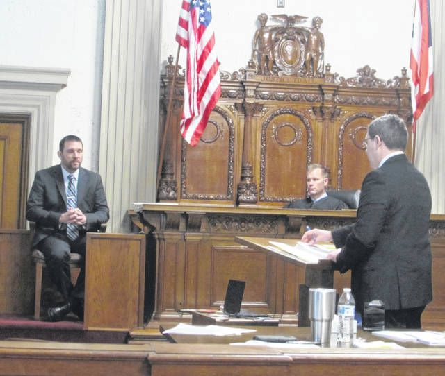 Aaron Giesige, Putnam County Sheriff's Office detective, testifies Tuesday with Keith Schierloh, Putnam County Common Pleas Court judge and Todd Schroeder, assistant prosecuting attorney.