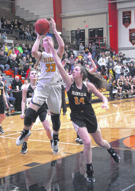 Ottawa-Glandorf's Erin Kaufman (33) puts up a shot against Fairview's Olivia Ricica during Saturday's Division III district final at Elida.