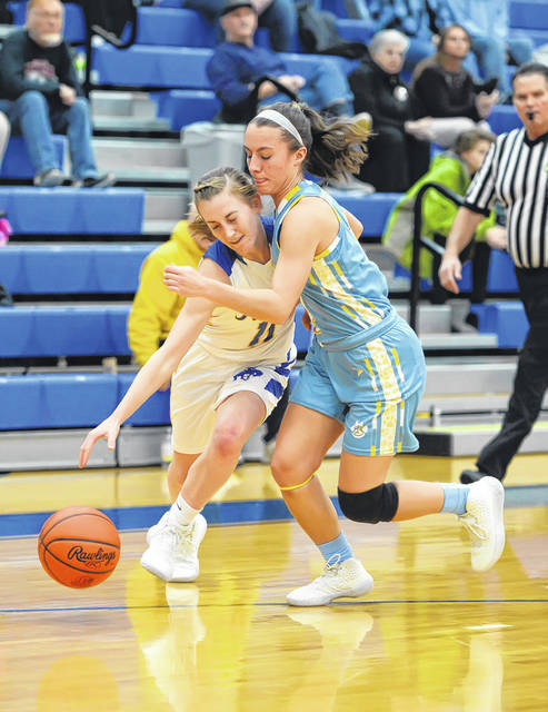 Bath's Abbie Dackin tries to get the ball away from St. Marys' Kendall Dieringer dribbles against during Thursday night's game at St. Marys.