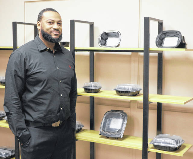 Production manager Vernon Hines shows off some of the products made at deSter in Lima.