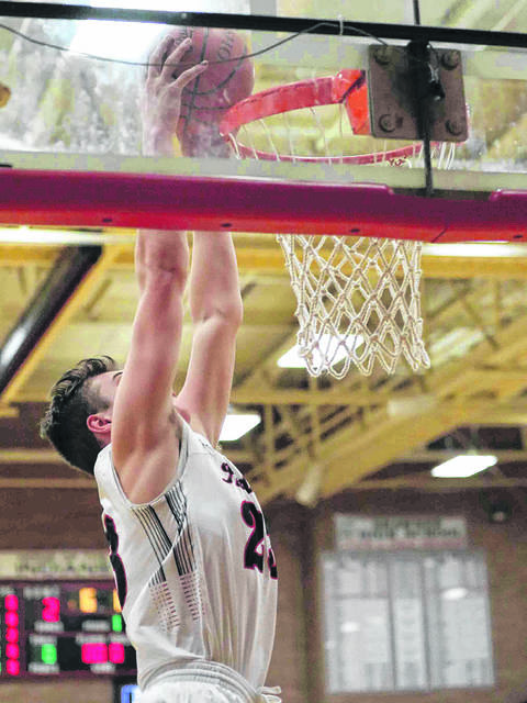 Shawnee's George Mangas goes up for a dunk during a recent home game against Kenton. The Indians are one of the teams to watch this season.