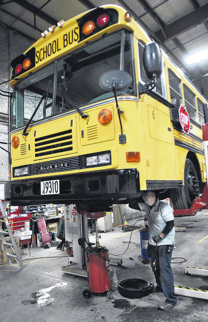 Dave Mitchell, a mechanic for the Lima schools bus garage, performs maintenance work on a school bus. Buses are such a big investment that maintenance becomes a huge part of keeping them running well and able to be relied upon.
