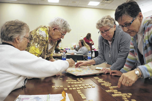 More than a dozen teams competed in the Northwest Ohio Literacy Council's annual Scrabble tournament Saturday.