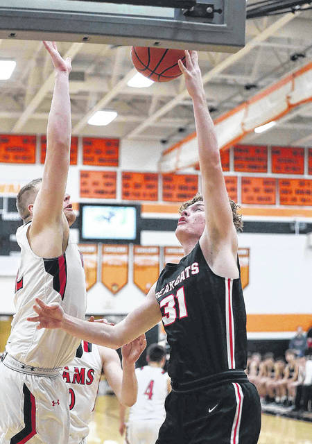 Spencerville's Dalton Prichard puts up a shot against Upper Scioto Valley's Quinn Sanders during a Tuesday night Division IV sectional semifinal at Coldwater.
