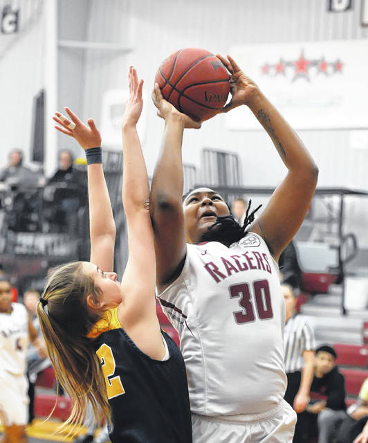 University of Northwestern Ohio's Kimyra McGhee, who scored nine points and grabbed 10 rebounds, puts up a shot against Siena's Allye Minor during Wednesday's game at The Garage. The Racers picked up a 71-69 win.