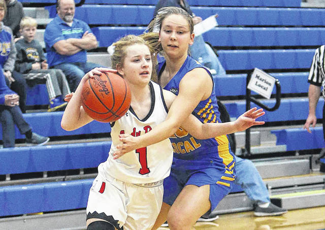 Marion Local's Demange tries to make the steal on Upper Scioto Valley's Kennedy Hall in the first half during the Division lV sectional at St.Marys High School Wednesday.