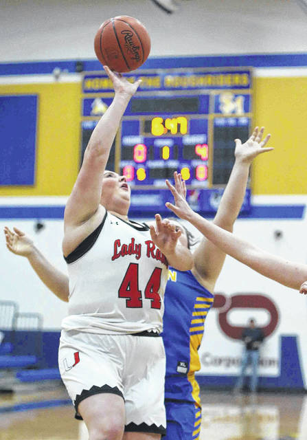 Upper Scioto Valley's Graesan Evans shoots over Marion Local's Molly Winner in the first quarter during the Girls Division lV sectional at St.Marys High School Wednesday.