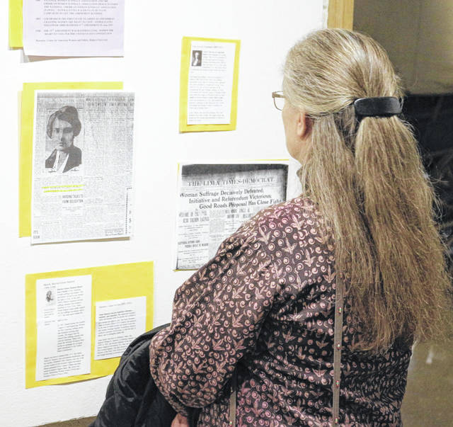 Sharon Wildermuth, of Lima, looks over a display at the Allen County Museum about giving women the right to vote.