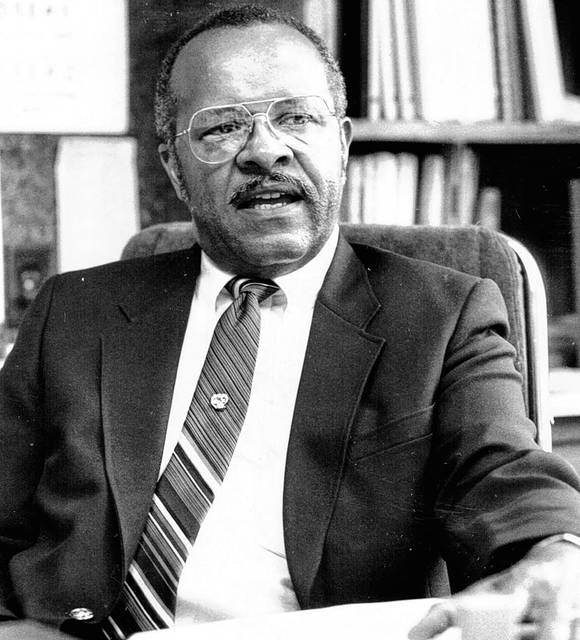 """Dr. Melvin J. """"Mel"""" Woodard II seated in his office, photographed in 1989. He was the first African American man to run for mayor of Lima, doing so in 1969."""