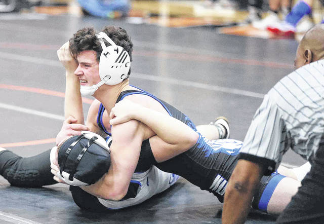 Allen East's Drake Carmean, right, gets the advantage against Lincolnview's Maddy Allen during Saturday's Division III duals regional in Coldwater.