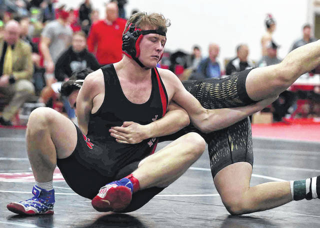 Delphos Jefferson's Kane Plescher, left, competes against Parkway's Kaine Younker during Saturday's Division lll sectional at Lima Central Catholic.