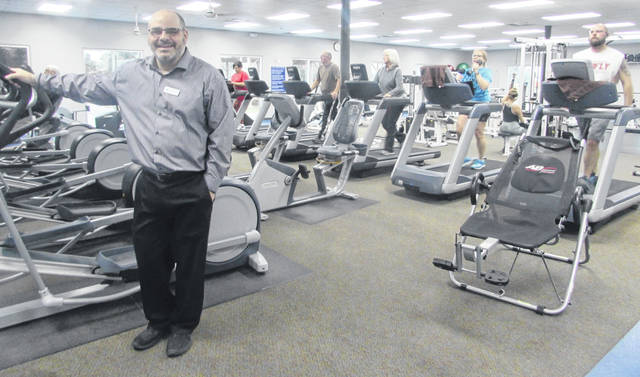 Aaron Baumgartner, Putnam County YMCA CEO and executive director, is pictured in the 24/7 Mercy Health Fitness Center. The Y is celebrating 15 years this month of being in the new facility.