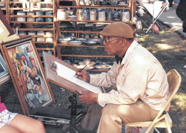 Melvin Hubbard sketches during an undated Lima Art Association event called Once Upon a Sunday.