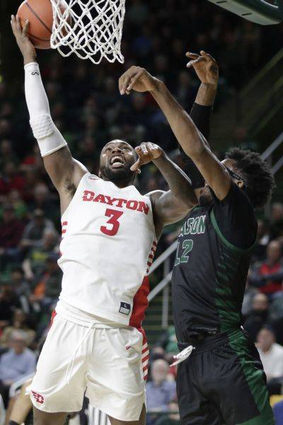 Dayton's Trey Landers (3) puts up a shot against George Mason's AJ Wilson, right, during Tuesday night's game in Fairfax, Va. (AP photo)